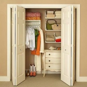 Want to save space?  Put your dresser in your closet!  This is a lovely example of using a dresser efficiently.