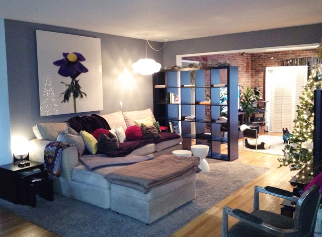 By placing one side against the wall and having the shelf jut out into a  room, it makes a perfect semi-wall. Need a visual? Check out this blog post.