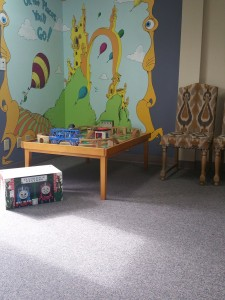 "Kids love this play area so much that Dr. Gregory has been dubbed ""The Train Doctor"" !"